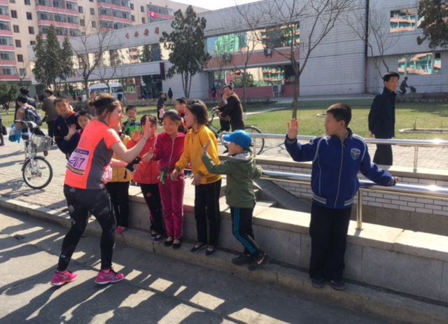 American runners take brief moments to connect with the citizens of Pyongyang. (Courtesy Kathy Whitmer)