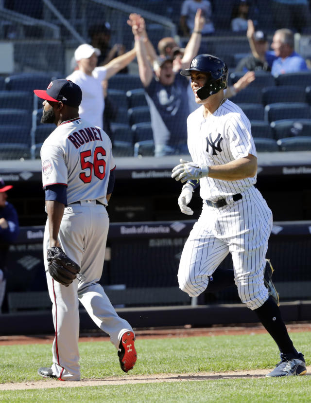 New York Yankees' Giancarlo Stanton runs past Minnesota Twins relief pitcher Fernando Rodney (56) to score on a three-run home run by Gary Sanchez during the ninth inning of a baseball game Thursday, April 26, 2018, in New York. The Yankees won 4-3. (AP Photo/Frank Franklin II)