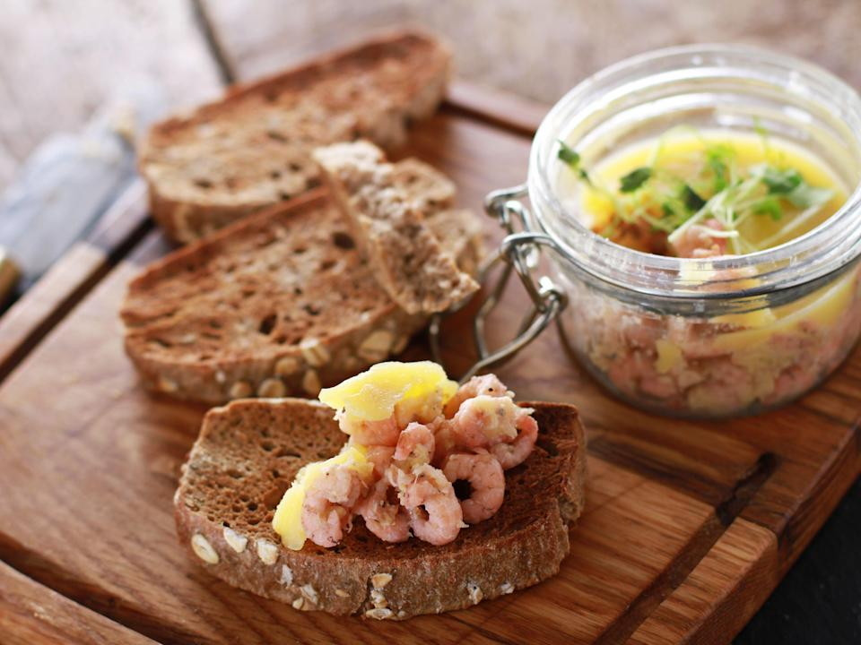 potted shrimp appetizer served with toasted brown bread