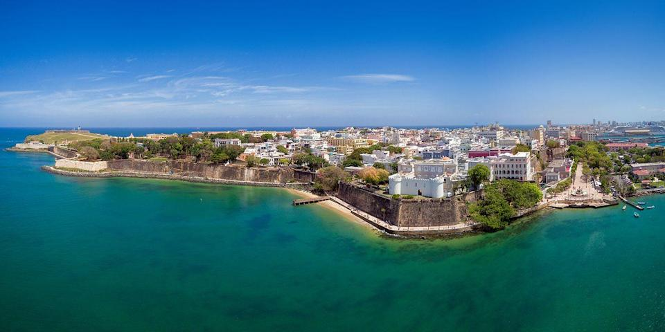 """<p>Puerto Rico was hit hard by Hurricane Maria, but San Juan's resort areas are very much up and running (the island welcomes tourism dollars). Hotels like the <a rel=""""nofollow noopener"""" href=""""https://www.hotels.com/ho208479/"""" target=""""_blank"""" data-ylk=""""slk:Courtyard by Marriott Isle Verde"""" class=""""link rapid-noclick-resp"""">Courtyard by Marriott Isle Verde</a> are right on the beach, while the <a rel=""""nofollow noopener"""" href=""""https://www.hotels.com/ho181282/"""" target=""""_blank"""" data-ylk=""""slk:Hotel El Convento"""" class=""""link rapid-noclick-resp"""">Hotel El Convento</a>, in a former convent, is located in Old San Juan, known for its Spanish colonial architecture and El Morro Fort. You'll also find buzzy restaurants, casinos, rum bars (the <a rel=""""nofollow noopener"""" href=""""https://www.tripadvisor.com/Attraction_Review-g1675690-d150138-Reviews-Casa_Bacardi_Visitor_Center-Catano_Puerto_Rico.html"""" target=""""_blank"""" data-ylk=""""slk:Bacardi Distillery"""" class=""""link rapid-noclick-resp"""">Bacardi Distillery</a> is nearby), and salsa clubs. </p>"""