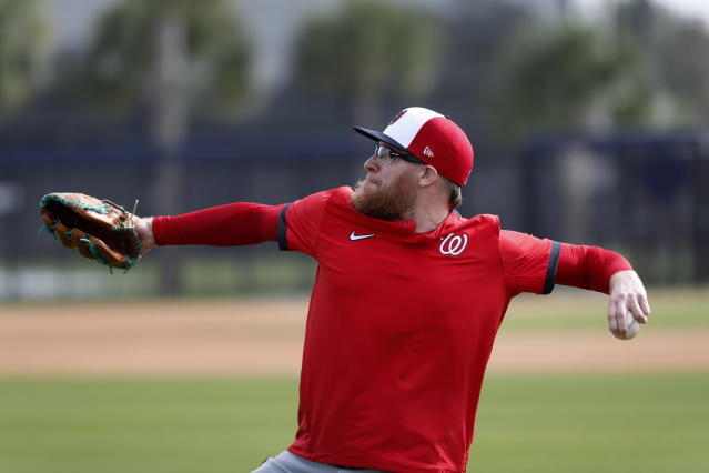 Washington Nationals pitcher Sean Doolittle throws during spring training baseball practice Friday, Feb. 14, 2020, in West Palm Beach, Fla. (AP Photo/Jeff Roberson)