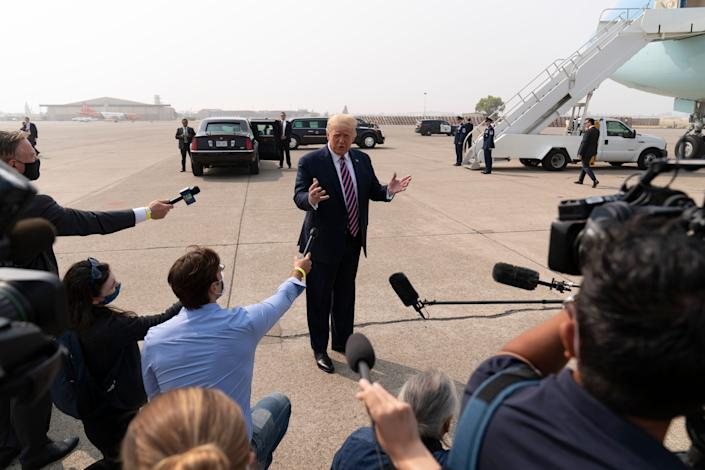 President Donald Trump arrives at Sacramento McClellan Airport to survey wildfire damage in California on Sept. 14.