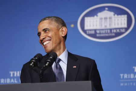 U.S. President Barack Obama smiles during remarks at the White House Tribal Nations Conference in Washington