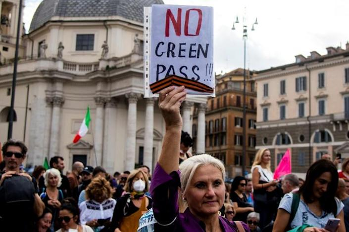 Anyone caught in the workplace without a Green Pass risks fines ranging from 600 to 1,500 euros (AFP/Tiziana FABI)