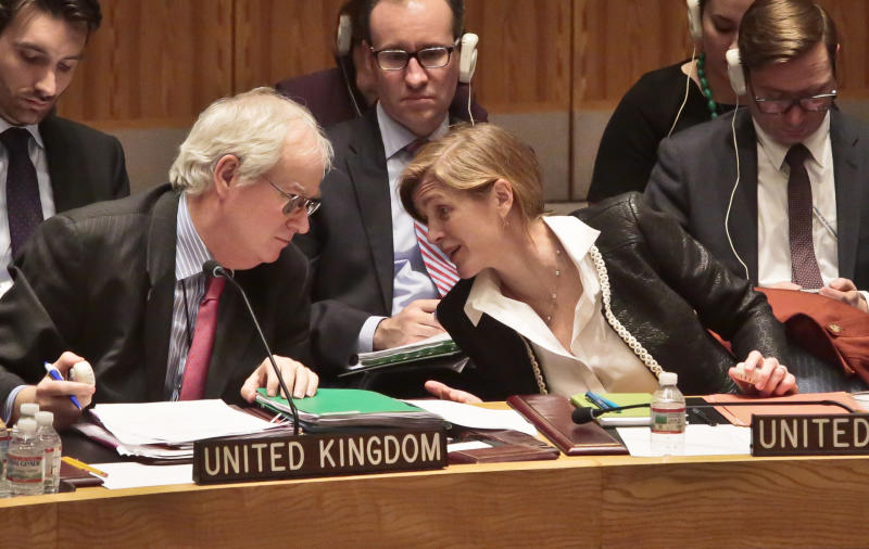 U.N. United Kingdom Ambassador Mark Lyall Grant, left, and U.S. Ambassador to the U.N. Samantha Power confer during a meeting of the U.N. Security Council on the crisis in the Ukraine, Wednesday March 19, 2014, at United Nations Headquarters. (AP Photo/Bebeto Matthews)
