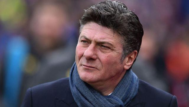 "<p>Another Premier League relative newbie with little background to go on. Mazzarri looks a bit like a scowly Alec Baldwin and is partial to a pair of aviators. </p> <br><p>He does earn bonus points for <a href=""http://www.bbc.co.uk/sport/football/38870795"" rel=""nofollow noopener"" target=""_blank"" data-ylk=""slk:getting angry even when his Watford team win"" class=""link rapid-noclick-resp"">getting angry even when his Watford team win</a>.</p>"