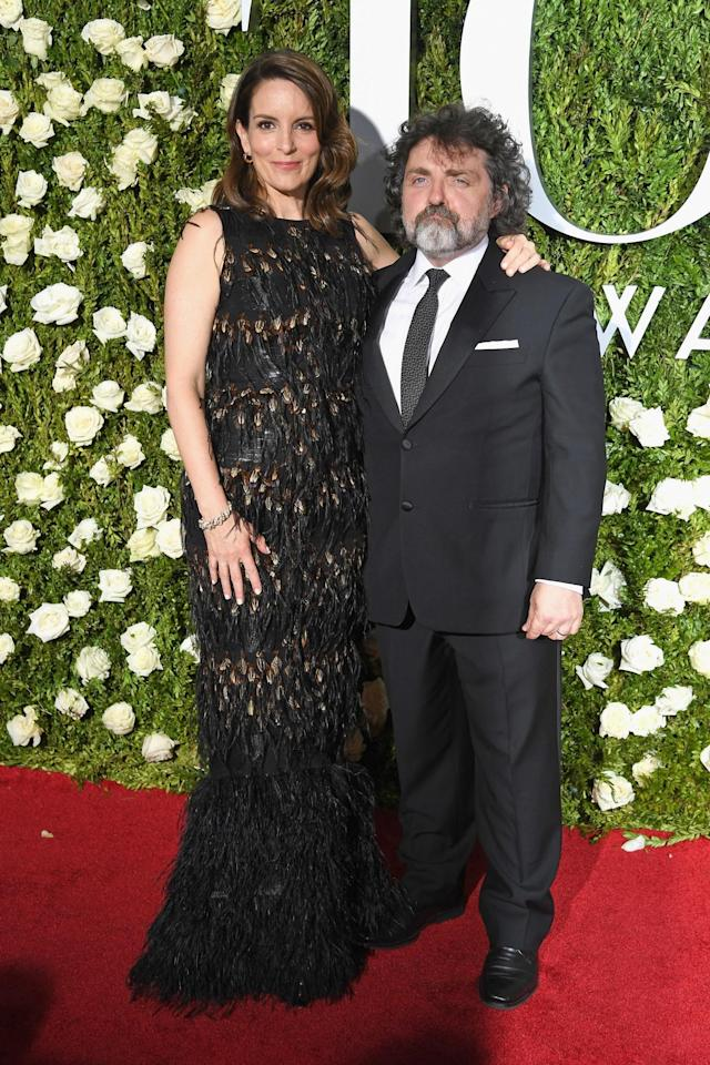<p>The writer/actress, with her husband Jeff Richmond, wore an on-point dress by the New York designer. (Photo: Getty Images) </p>