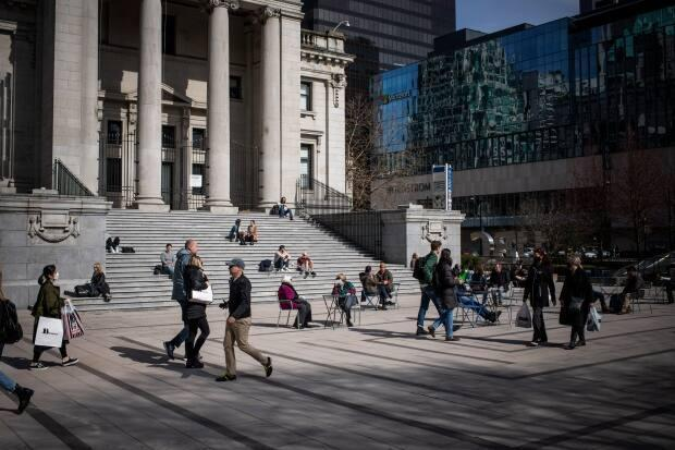 The section of Robson Street between the Vancouver Art Gallery and Law Courts has been converted into a permanent public plaza as part of a $5.38-million revamp.  (Ben Nelms/CBC - image credit)