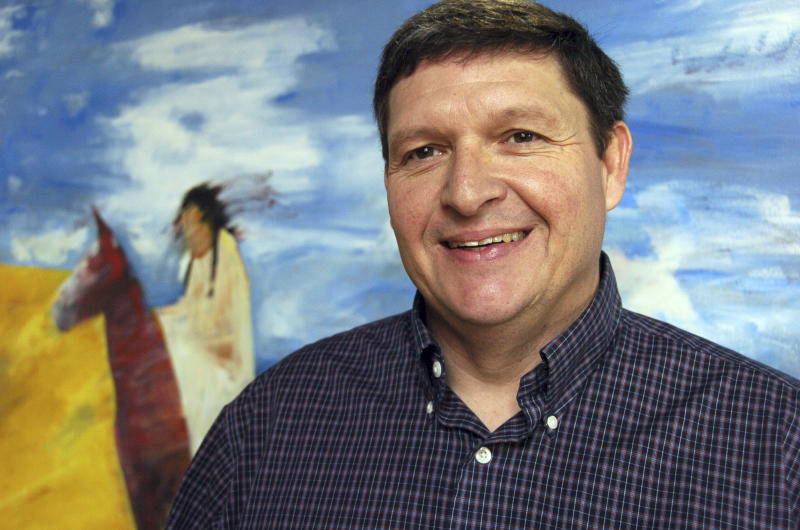 FILE - In this Friday, Nov. 16, 2012, file photo, Gerald Gray, chairman of Montana's Little Shell Band of Chippewa Indians, poses at the advertising agency where he works in Billings, Mont. The U.S. Senate on Tuesday, Dec. 17, 2019 approved a measure under which the federal government would formally recognize the tribe following its decades-long struggle for acknowledgement. (AP Photo/Matthew Brown, File)