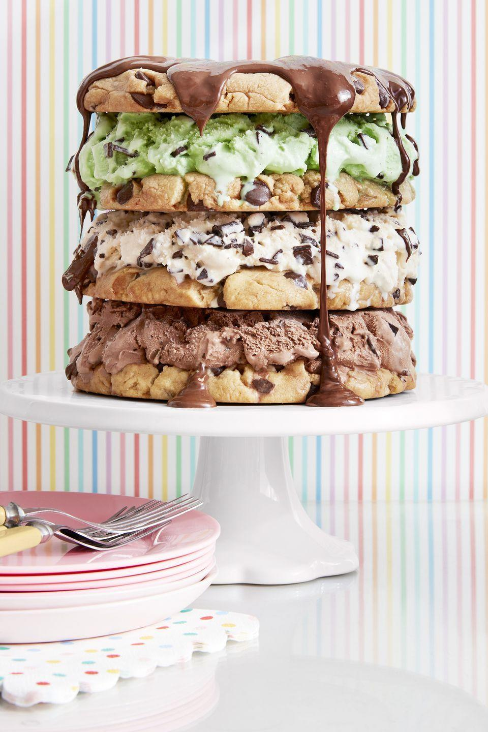 """<p>Mix and match ice cream flavors—pistachio, chocolate, vanilla, and more!—for a multi-colored display. </p><p><strong><a href=""""https://www.countryliving.com/food-drinks/a20748234/chocolate-chip-cookie-cake-recipe/"""" rel=""""nofollow noopener"""" target=""""_blank"""" data-ylk=""""slk:Get the recipe"""" class=""""link rapid-noclick-resp"""">Get the recipe</a>.</strong></p>"""