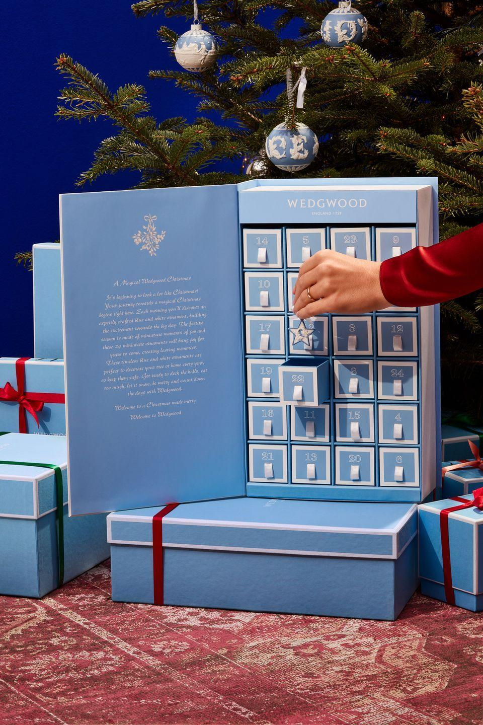"""<p>This advent calendar from heritage British pottery house Wedgwood is a far cry from cheap festive chocolate. Behind each box is an exquisite porcelain tree decoration in signature blue and white, strung with a white satin ribbon. Mini replicas of some of its most iconic designs are seriously special – think lilliputian-esque versions of the 'Jasper Portland Vase' and 'Venus Bust', plus dinky teapots and traditional coffee pots. £650, <a href=""""https://www.wedgwood.com/en-gb/home-decor/decorative-accessories/christmas-decorations/christmas-2020-advent-calendar-book-1051625"""" rel=""""nofollow noopener"""" target=""""_blank"""" data-ylk=""""slk:wedgwood.com"""" class=""""link rapid-noclick-resp"""">wedgwood.com</a></p>"""