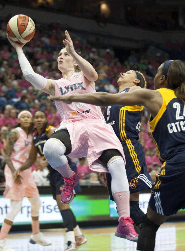 Minnesota Lynx guard Lindsay Whalen (13) shoots against Indiana Fever guard Layshia Clarendon (5) during the first half of a WNBA basketball game on Saturday, Aug. 24, 2013, in Minneapolis. Indiana forward Erlana Larkins (2) also defends on the play. (AP Photo/Paul Battaglia)