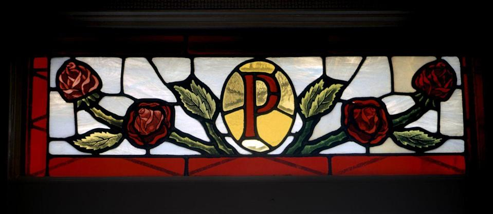 "<p>Elvis installed a stained glass window above the front door of the house to welcome visitors to their home, which featured the letter ""P"" surrounded by red roses. </p>"