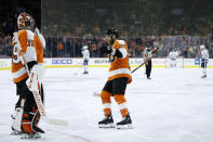 Philadelphia Flyers' Claude Giroux (28) celebrates with Carter Hart (79) after a goal during the third period of an NHL hockey game against the Toronto Maple Leafs, Tuesday, Dec. 3, 2019, in Philadelphia. (AP Photo/Matt Slocum)