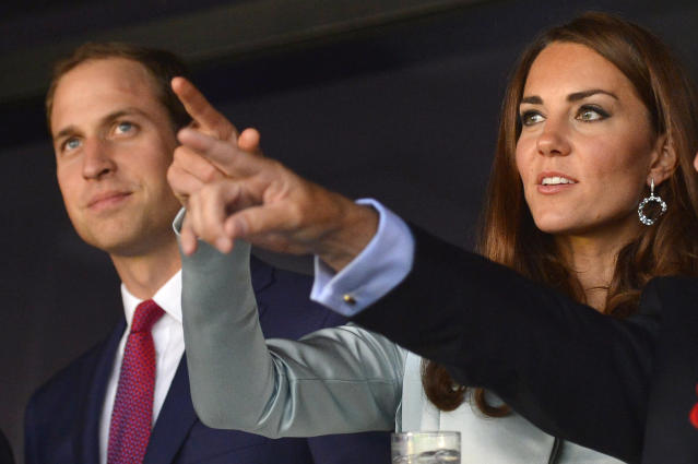 LONDON, ENGLAND - JULY 27: Prince William, Duke of Cambridge (L) and Catherine, Duchess of Cambridge attend the Opening Ceremony of the London 2012 Olympic Games at the Olympic Stadium on July 27, 2012 in London, England. (Photo by Toby Melville - IOPP Pool /Getty Images)