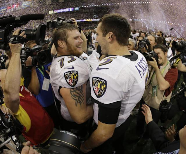 Baltimore Ravens quarterback Joe Flacco (5) and offensive lineman Marshal Yanda (73) celebrate their team's 34-31 win against the San Francisco 49ers in the NFL Super Bowl XLVII football game, Sunday, Feb. 3, 2013, in New Orleans. (AP Photo/Matt Slocum)