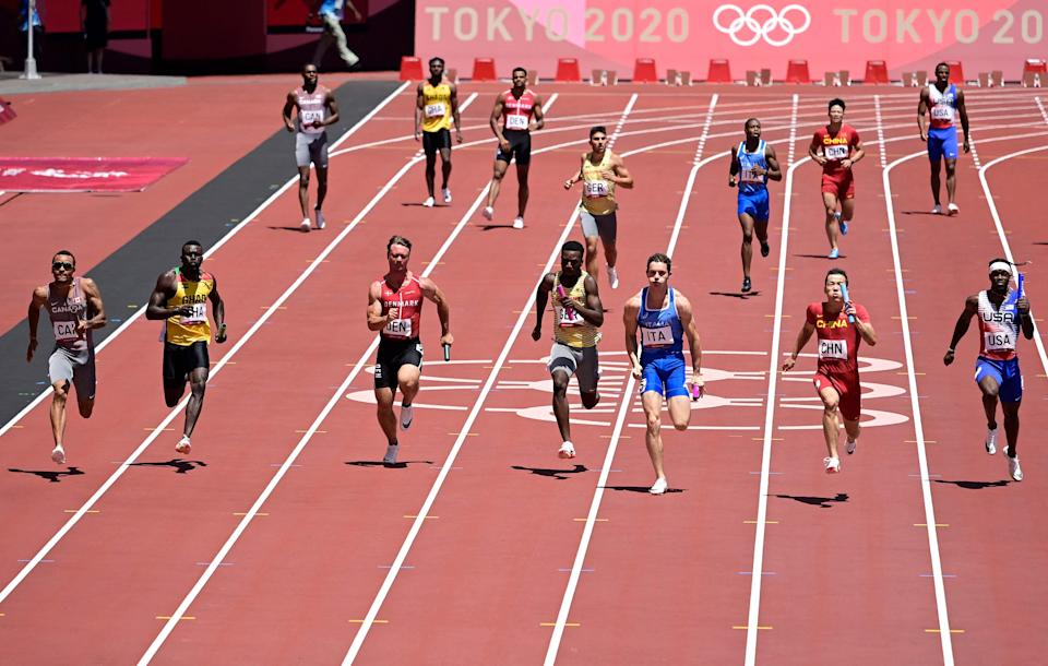 The U.S. men, far right lane, finished sixth in their semifinal heat in the 4x100 relay and did not qualify for the final.
