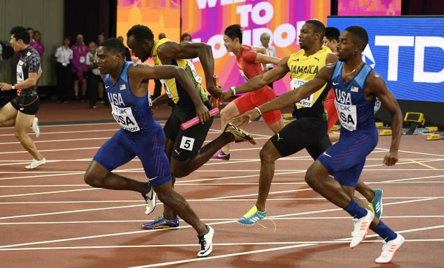 Athletics - World Athletics Championships - Men's 4x100 Metre Final - London Stadium, London, Britain – August 12, 2017. Yohan Blake of Jamaica passes the baton to Usain Bolt before he sustains an injury. REUTERS/Dylan Martinez