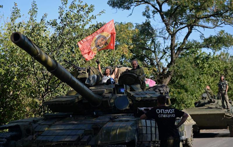 Pro-Russian fighters sit on top of a tank in Starobesheve, southeast of Donetsk, on August 31, 2014 (AFP Photo/Francisco Leong)