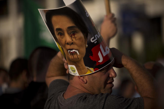 """<p>A member of the Islamic Movement in Israel, a political movement for Arab Muslims inside Israel, displays a defaced poster of Myanmar's State Counsellor Aung San Suu Kyi during a demonstration to condemn Myanmar's treatment of the Muslim Rohingya minority, in front of the embassy of Myanmar, in Tel Aviv, Israel, Monday, Sept. 11, 2017. Protest leader Ibrahim Sarsour said the crowd came to condemn what he called """"atrocities"""" committed by the Myanmar government. (Photo: Oded Balilty/AP) </p>"""