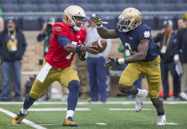 Notre Dame's Brandon Wimbush (7) hands off the ball to Dexter Williams (2) during the Notre Dame Blue-Gold Spring college football game Saturday, April 21, 2018, inside Notre Dame Stadium in South Bend, Ind. (Robert Franklin/South Bend Tribune via AP)