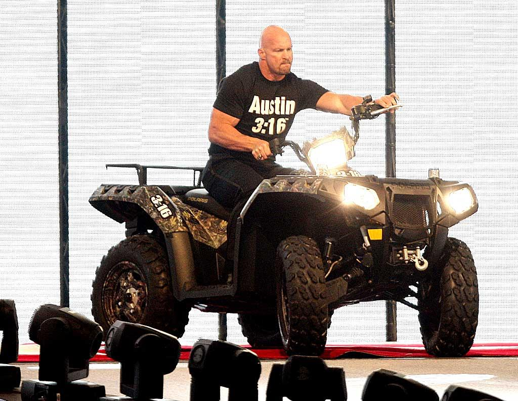 "Also in attendance? Stone Cold Steve Austin, who celebrated his recent induction into the WWE Hall of Fame by riding an ATV around the arena. Bob Levey/<a href=""http://www.wireimage.com"" target=""new"">WireImage.com</a> - April 5, 2009"
