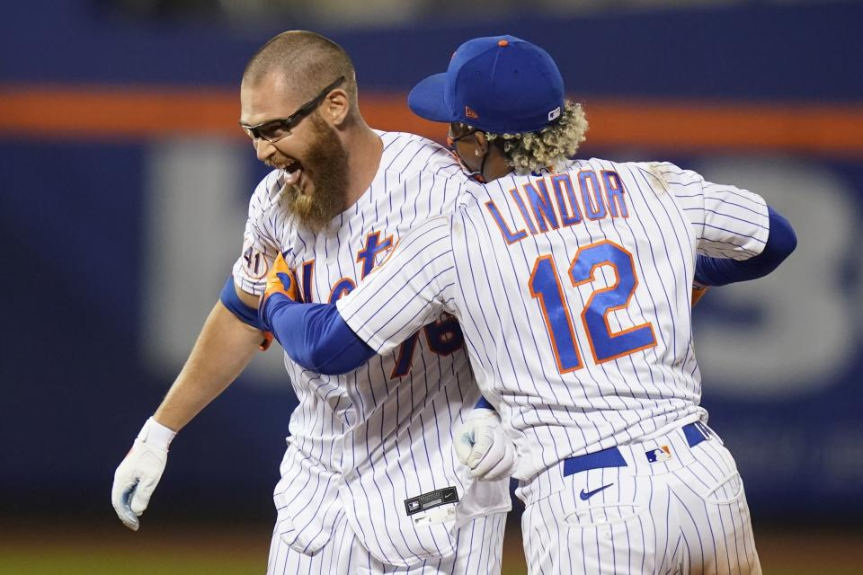 New York Mets' Francisco Lindor, right, celebrates with Patrick Mazeika after the team's baseball game against the Baltimore Orioles on Tuesday, May 11, 2021, in New York. The Mets won 3-2. (AP Photo/Frank Franklin II)