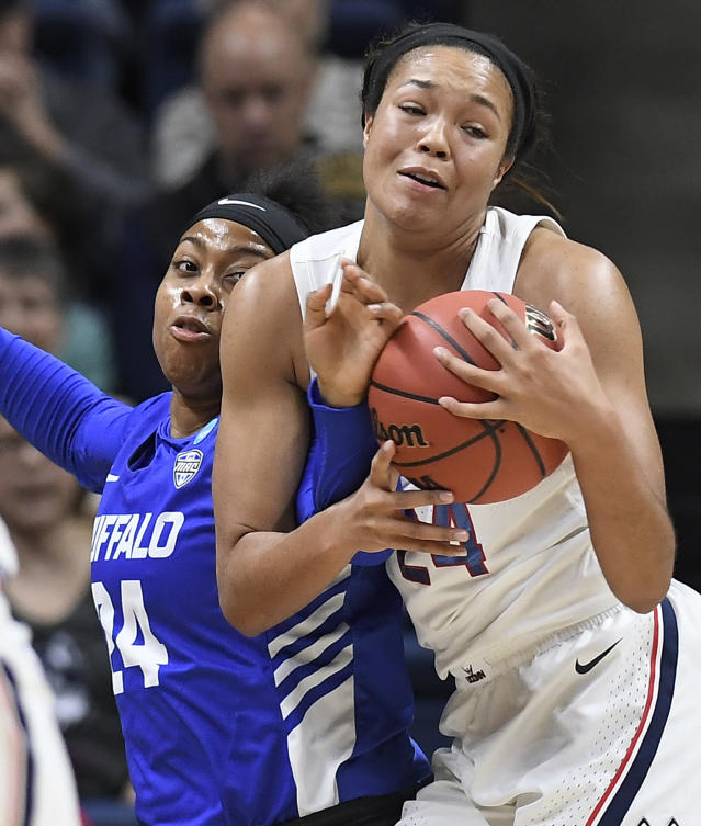 Buffalo's Cierra Dillard, left, pressures Connecticut's Napheesa Collier during the first half of a second-round women's college basketball game in the NCAA tournament Sunday, March 24, 2019, in Storrs, Conn. (AP Photo/Jessica Hill)