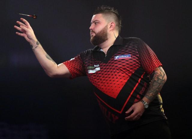 Michael Smith, pictured, was knocked out in the second round by Lowe (Adam Davy/PA)