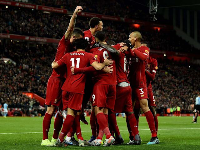 Liverpool celebrate after scoring their third against City: Getty