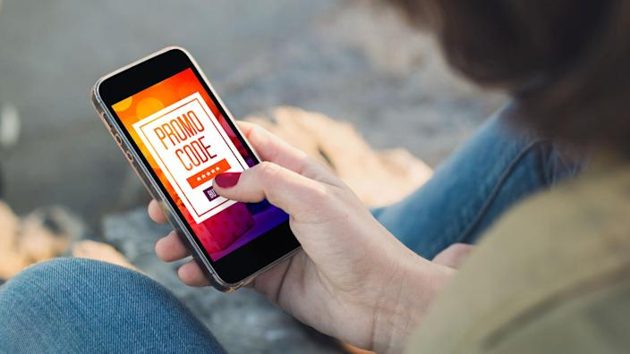 looking up online coupon codes on smartphone