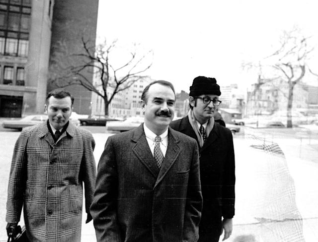 <p>Three of the seven defendents — including G. Gordon Liddy, center — charged in connection with the break-in and alleged bugging of Democratic headquarters arrive at U.S. District Court for the start of their trial on Jan. 8, 1973. The other men are unidentified. (Photo: AP) </p>