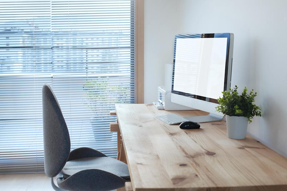 workspace interior with computer on wooden table and office chair, modern workplace