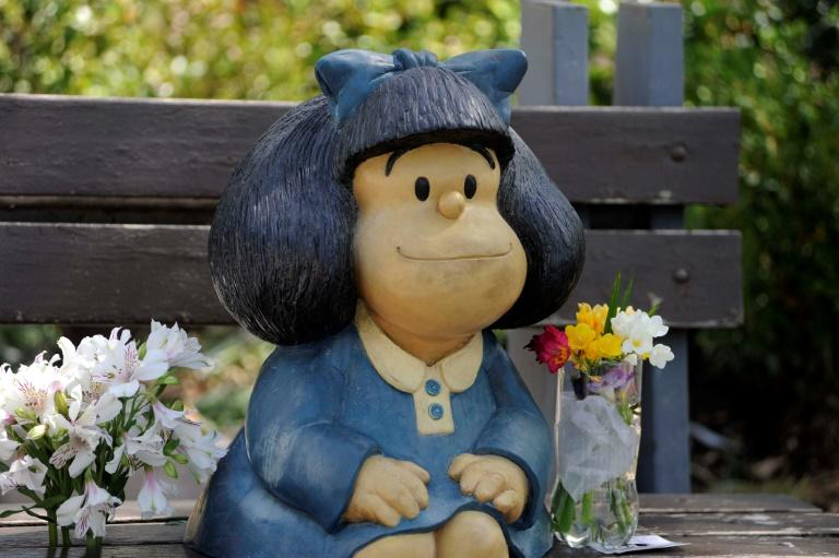 Flowers left by members of the public at a statue of Mafalda in Buenos Aires, after the announcement of the death of her cartoonist creator Quino