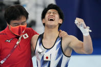 <p>Daiki Hashimoto, of Japan, celebrates with his coach after winning the gold medal in the artistic gymnastics men's all-around final at the 2020 Summer Olympics, Wednesday, July 28, 2021, in Tokyo. (AP Photo/Gregory Bull)</p>