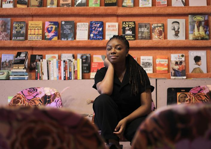 "Jazzi McGilbert, the owner of Reparations Club, says her bookshelves are ""curated by blackness."" <span class=""copyright"">(Myung J. Chun/Los Angeles Times)</span>"