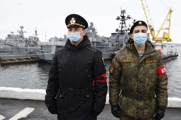 Russian sailors stand guard near the Northern Fleet's flagship, the Pyotr Veilikiy (Peter the Great) missile cruiser, at its Arctic base of Severomorsk, Russia, Thursday, May 13, 2021. Adm. Alexander Moiseyev, the commander of Russia's Northern Fleet griped Thursday about increased NATO's military activities near the country's borders, describing them as a threat to regional security. (AP Photo/Alexander Zemlianichenko)