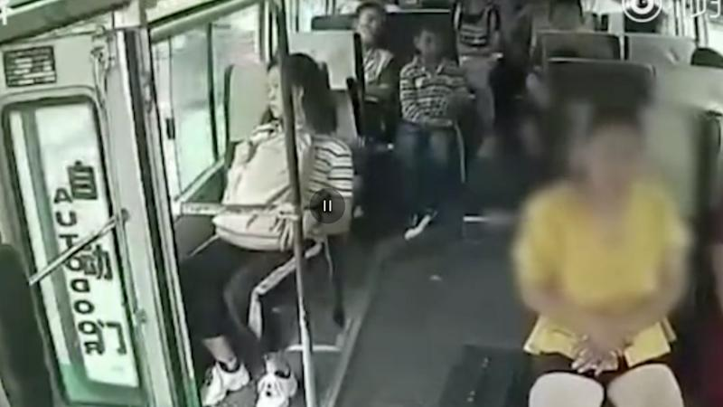 Safety questions after woman dies stepping off moving bus in China