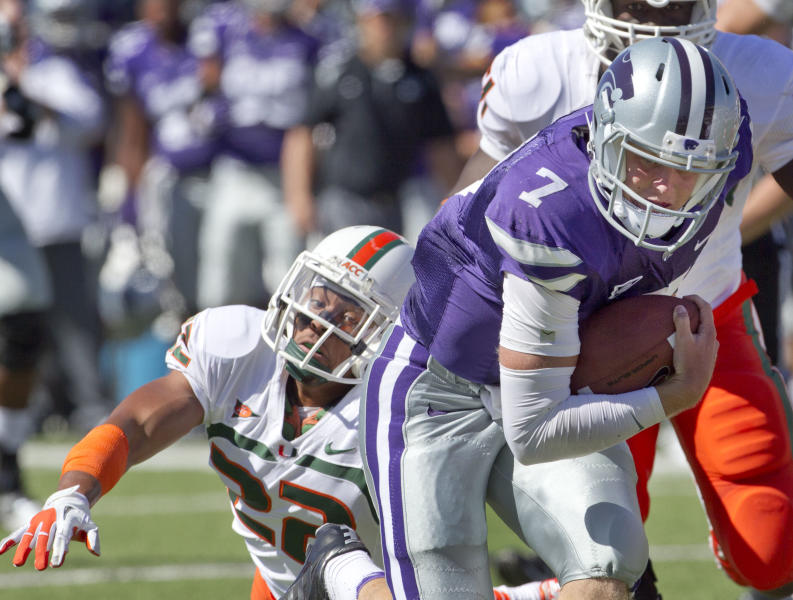 Kansas State quarterback Collin Klein (7) gets away from Miami defensive back Kacy Rodgers II (22) during the first half of an NCAA football game in Manhattan, Kan., Saturday, Sept. 8, 2012. (AP Photo/Orlin Wagner)
