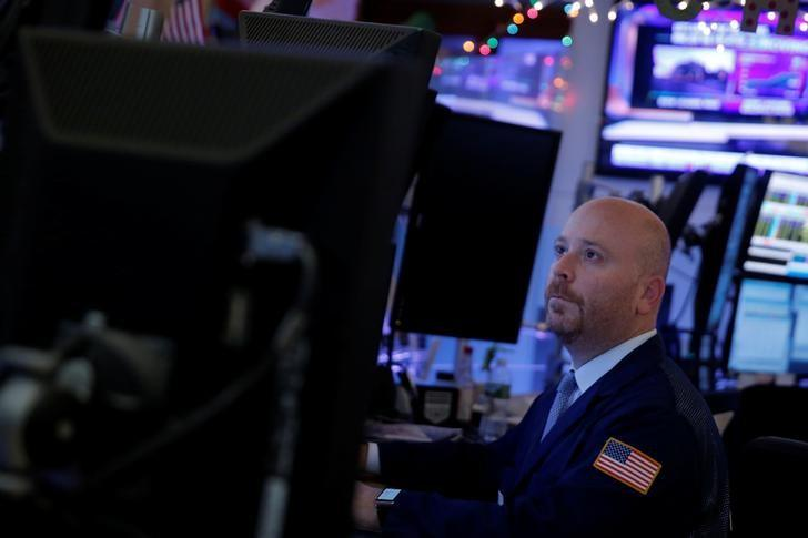 A trader works on the floor at the New York Stock Exchange (NYSE) in Manhattan, New York City, U.S.