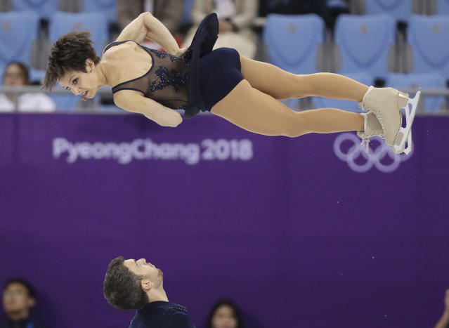 Meagan Duhamel and Eric Radford of Canada perform in the pair figure skating short program in the Gangneung Ice Arena at the 2018 Winter Olympics in Gangneung, South Korea, Wednesday, Feb. 14, 2018. (AP Photo/David J. Phillip)