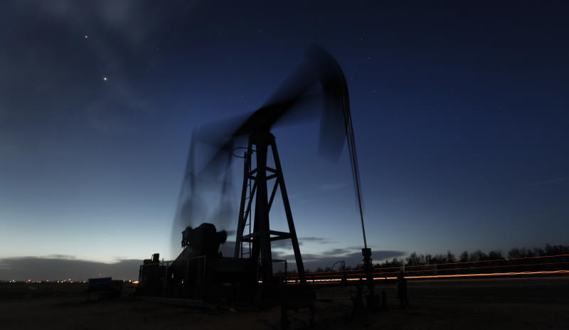 In this photo taken with a long exposure, a pumping unit sucks oil from the ground near Greensburg, Kan. Tuesday, March 6, 2012. The nationwide average for regular unleaded slipped less than a penny to $3.764 per gallon on Tuesday, March 6,2012. That ended a streak of price hikes that began on Feb. 8. (AP Photo/Charlie Riedel)