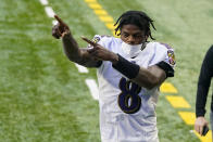 Baltimore Ravens quarterback Lamar Jackson (8) acknowledges fans as he leaves the field following an NFL football game against the Indianapolis Colts in Indianapolis, Sunday, Nov. 8, 2020. The Ravens defeated the Colts 24-10. (AP Photo/Darron Cummings)