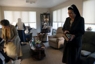Nuns of the Felician Sisters of North America conclude morning prayers at St. Anne Home in Greensburg, Pa., on Thursday, March 25, 2021. Last October the nuns lost one of their own, Sister Mary Evelyn Labik, to the coronavirus. (AP Photo/Jessie Wardarski)