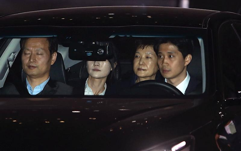 Ousted South Korean president Park Geun-hye (second right), leaves the prosecutors' office as she is transferred to a detention house in Seoul - GETTY IMAGES POOL