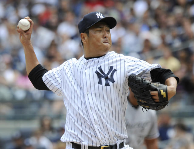 New York Yankees pitcher Hiroki Kuroda delivers to the Chicago White Sox during the first inning of a baseball game Saturday, Aug. 23, 2014, at Yankee Stadium in New York. (AP Photo/Bill Kostroun)