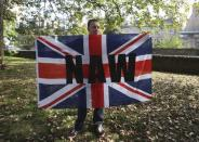 A supporter of the Orange Order holds a Union flag during a pro-Union rally in Edinburgh, Scotland September 13, 2014. REUTERS/Paul Hackett