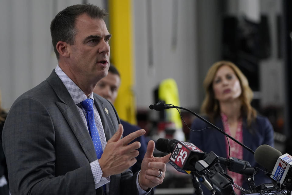 FILE - In this May 17, 2021 file photo, Oklahoma Gov. Kevin Stitt gestures as he speaks during a news conference in Oklahoma City. In a series of bills since last year, Congress has allocated nearly $200 billion billion to help public and private schools weather the coronavirus pandemic. Most of the money was required to be sent to local education agencies. (AP Photo/Sue Ogrocki)