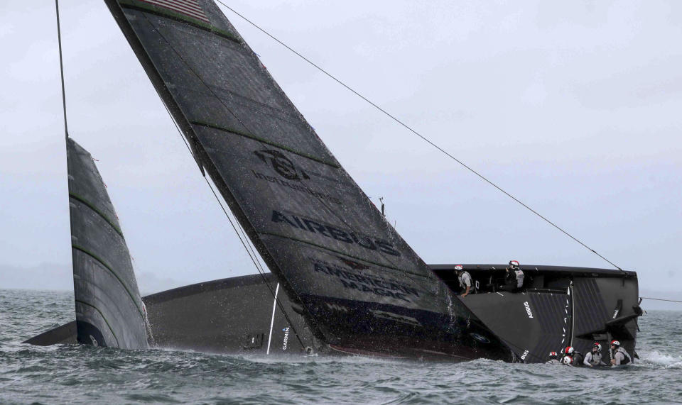 United States' American Magic capsizes during it's race against Italy's Luna Rossa on the third day of racing of the America's Cup challenger series on Auckland's Waitemate Harbour, New Zealand, Sunday, Jan. 17, 2021. (Michael Craig/NZ Herald via AP)