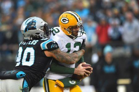 FILE PHOTO: Dec 17, 2017; Charlotte, NC, USA; Carolina Panthers defensive end Julius Peppers (90) sacks Green Bay Packers quarterback Aaron Rodgers (12) in the fourth quarter at Bank of America Stadium. Mandatory Credit: Bob Donnan-USA TODAY Sports
